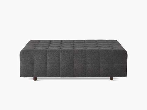 A Rapport ottoman upholstered in a dark grey fabric.