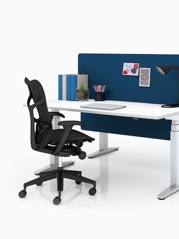 A Ratio height-adjustable desk. Select to go to the Ratio product page.