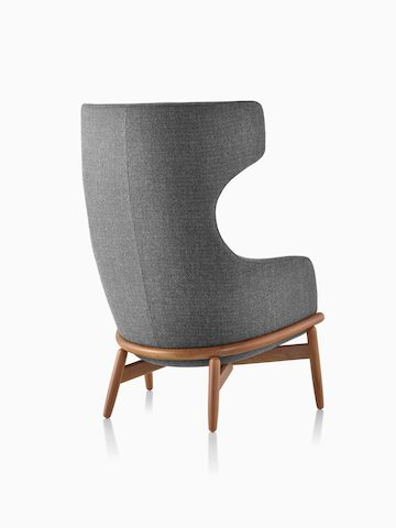 A wing-back Reframe Lounge Chair in Milaner Charcoal, viewed from behind.