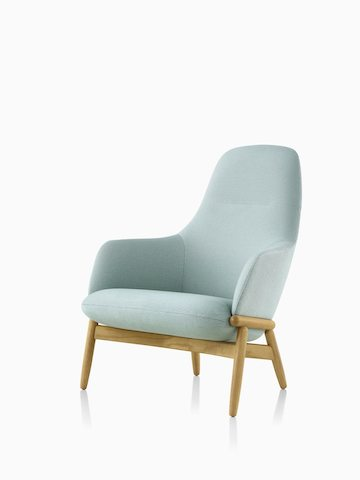 A high-back Reframe Lounge Chair in Saille Celadon, viewed from an angle. Select to go to the Reframe Lounge Seating product page.