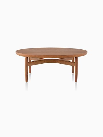 A Reframe Round Table in walnut, viewed from the front.