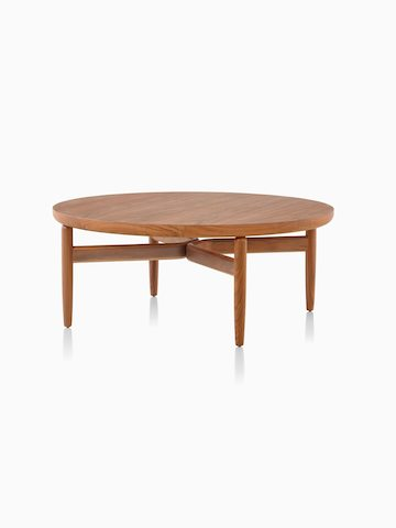 A Reframe Round Table in walnut, viewed from an angle.