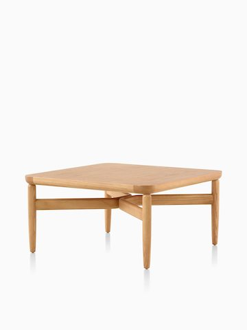 A Reframe Square Table in Rift oak, viewed from an angle. Select to go to the Reframe Tables product page.