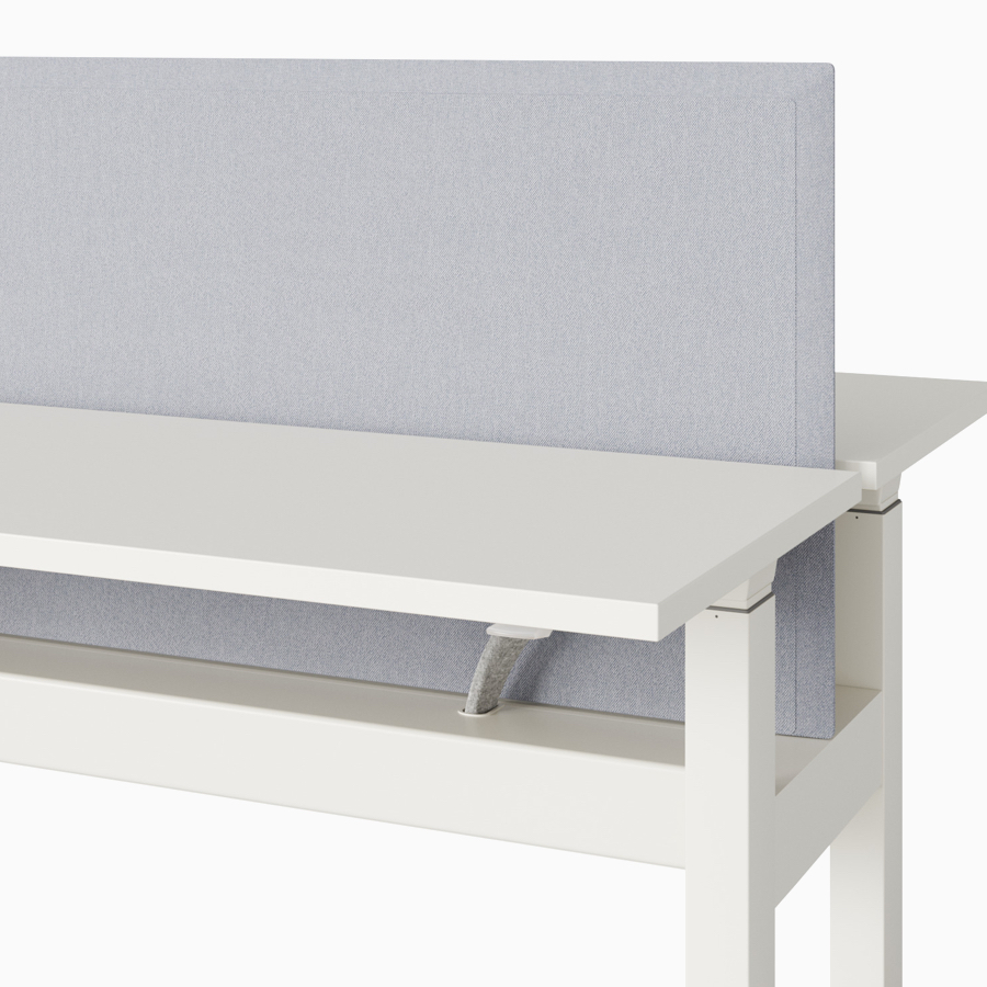 A close-up view of a Renew Link standing desk system's light gray trough-mounted screen.