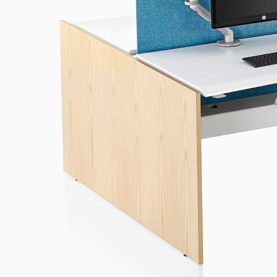 A close-up view of a Renew Link standing desk system's light wood gallery panel screen.