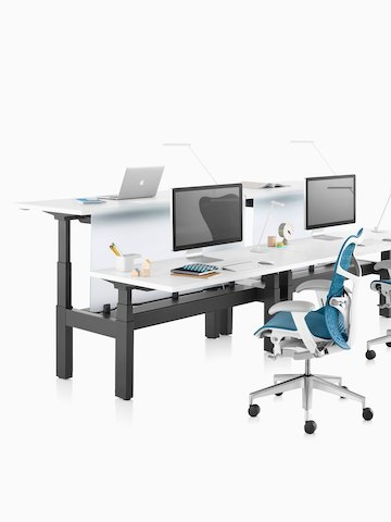 A benching application with blue Mirra 2 Chairs and Renew Link sit-to-stand surfaces in seated and standing positions.