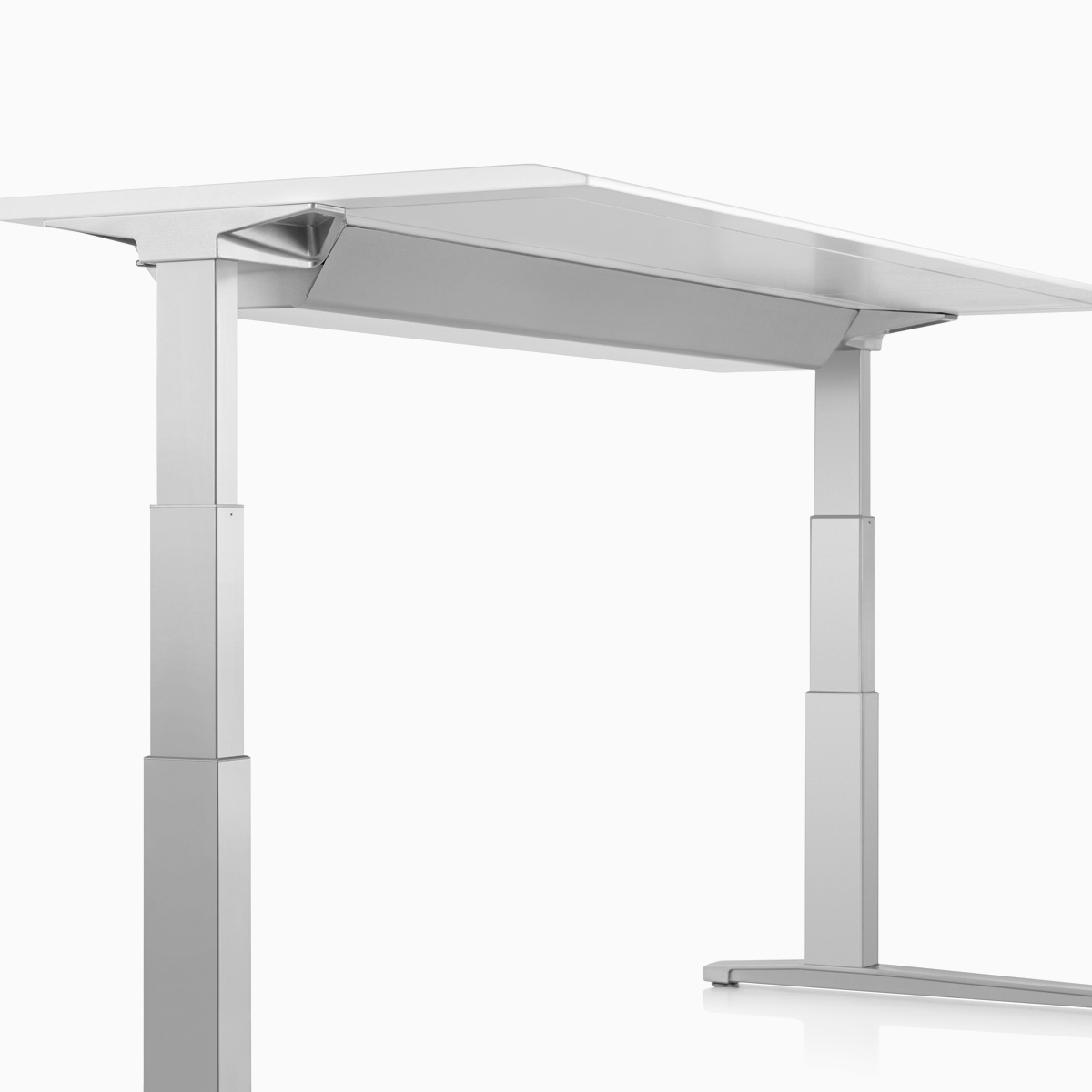 Viewed at an angle, a closed high-density cable tray that's attached to the underside of a Renew Sit-to-Stand Table's work surface.