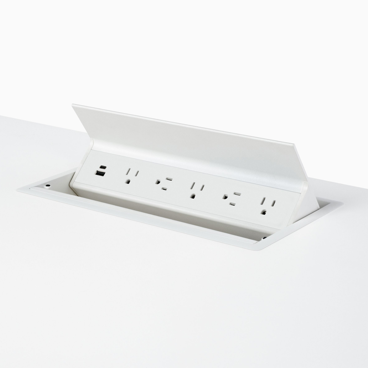 A white Logic G1000 with two USB connections and five power outlets integrated in the work surface of a Renew Sit-to-Stand Table.