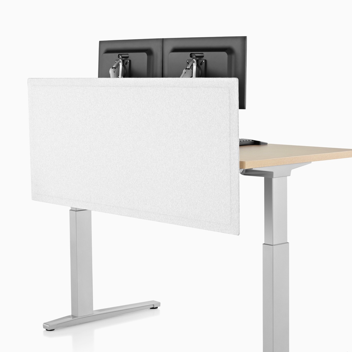 Viewed at an angle, the front side of a light gray, tapered-edge fabric, surface-attached screen on a rectangular Renew Sit-to-Stand Table.