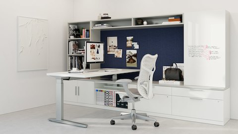 Two workpoints with black Aeron office chairs and Renew Sit-to-Stand Tables positioned at seated and standing heights.