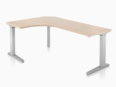 An oval Renew Sit-to-Stand Table with a tan top and gray legs.