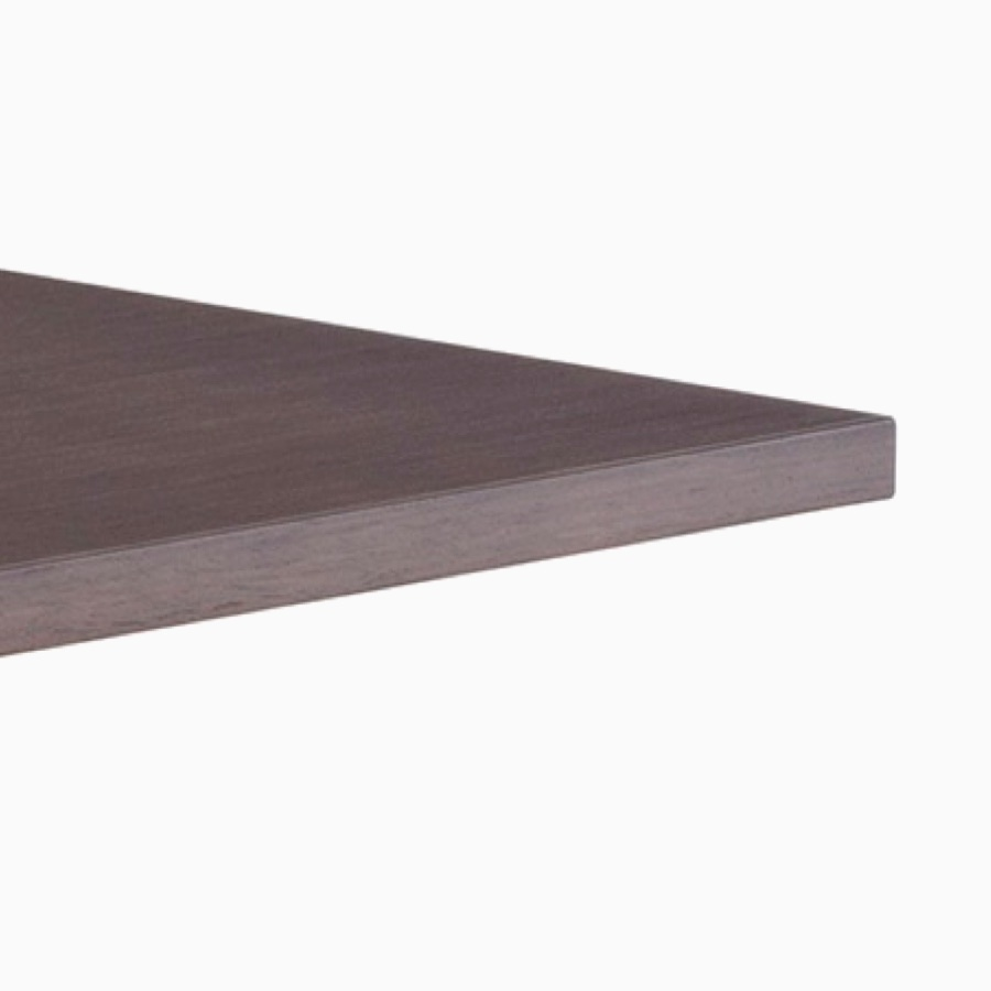 Close-up view of dark wood Renew Sit-to-Stand Table with a square edge work surface.