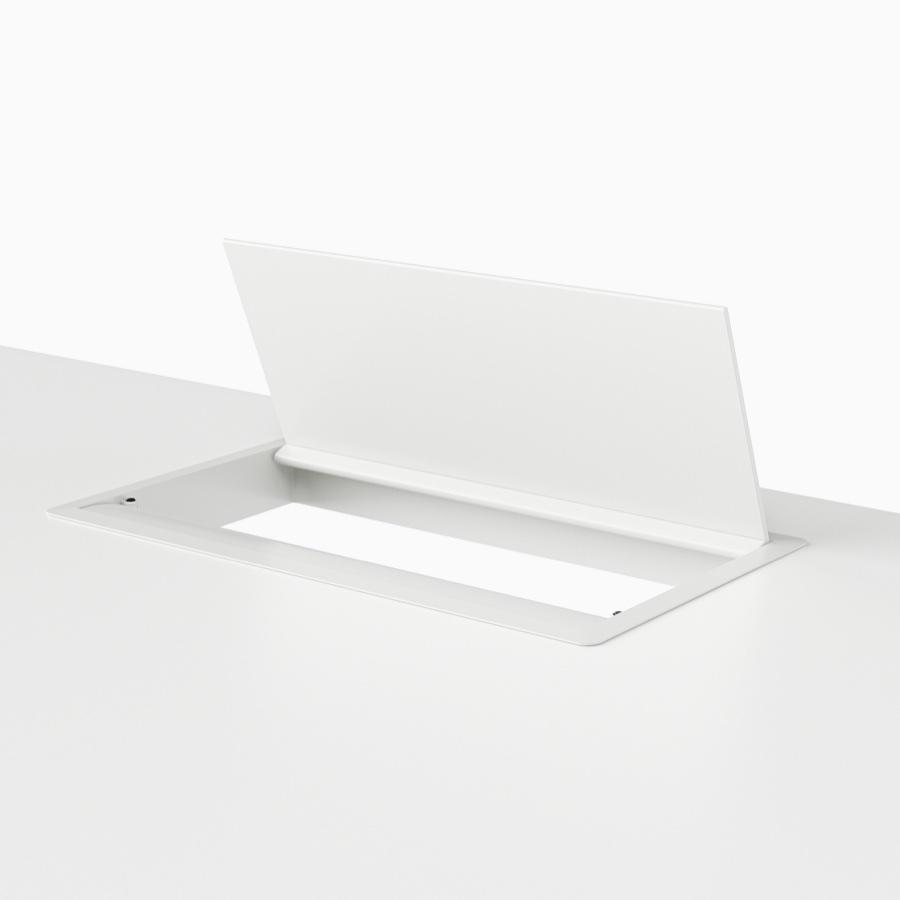 An open, white, desktop pop-up power port.