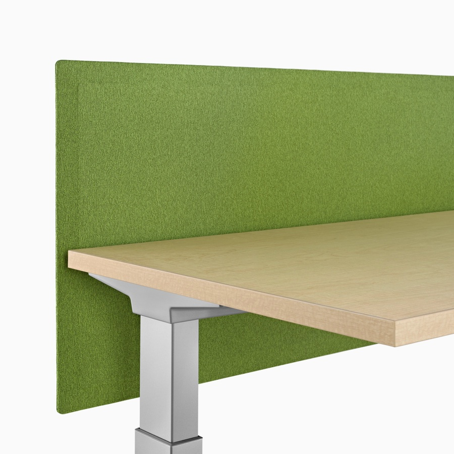 Close-up of a green fabric, Pari tapered edge, surface-attached privacy screen attached to a Renew Sit-to-Stand Table.