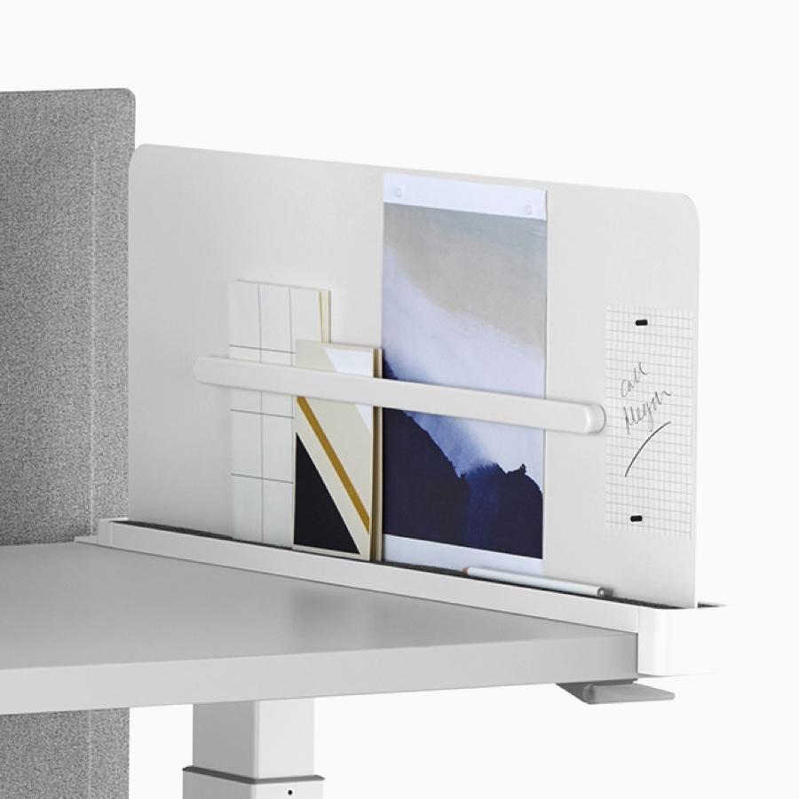 White Ubi Work Tools with a Renew Sit-to-Stand Table, including Ubi Slim Screen, Ubi Monitor Platform Shelf, Ubi Name Tag, and Ubi Mobile Bag Catch.