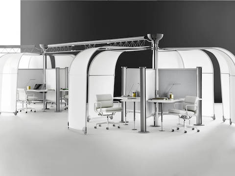A variety of Resolve System workstations with movable canopies and gray fabric dividing screens.
