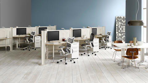 Gray Mirra 2 ergonomic desk chairs at a series of Resolve workstations with task lighting, storage, and monitors.