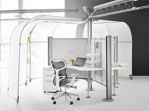 Gray Mirra 2 ergonomic desk chair at a Resolve workstation with movable canopies.