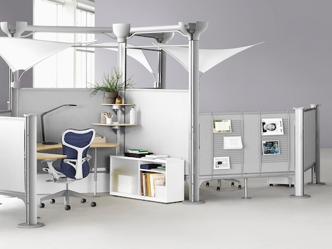 Blue Mirra 2 chair at a Resolve workstation with task lighting and overhead canopies.