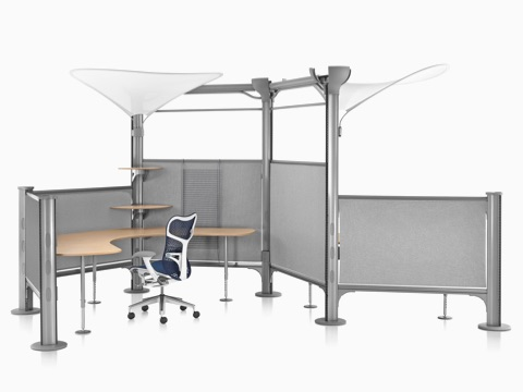 Blue Mirra 2 ergonomic desk chair at Resolve System workstation with gray fabric dividing panels.