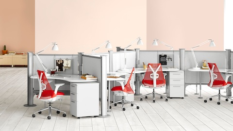 Red Sayl Chairs with white frames at Resolve system workstations with pedestal storage units.