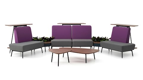 Three Sabha Collaborative Seating modules with purple backs and gray seats, each backed by a standing surface.