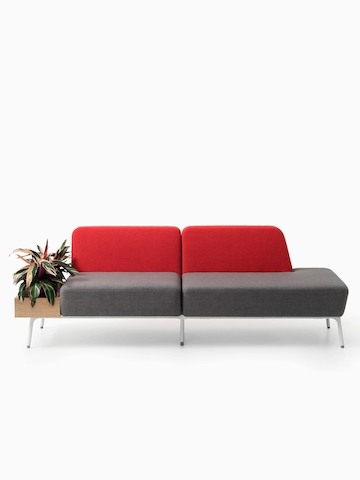A two-seat Sabha Collaborative sofa with a red back, gray seat, and built-in planter.