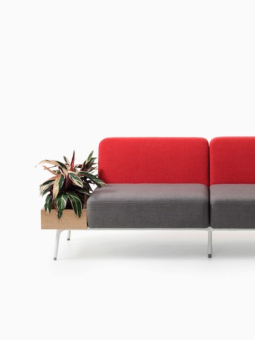 Red and grey Sabha seating with a built-in planter. Select to go to the Sabha Collaborative Seating product page.