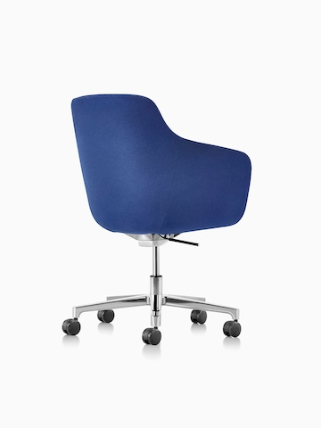 Three-quarter rear view of a mid-back Saiba executive chair in blue fabric with a polished five-star base and casters.