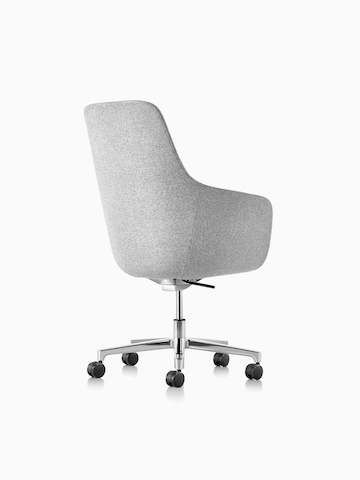 Three-quarter rear view of a high-back Saiba executive chair in light gray fabric with a polished five-star base and casters.
