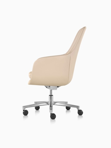 Profile view of a high-back Saiba executive chair in tan leather with a polished five-star base and casters.