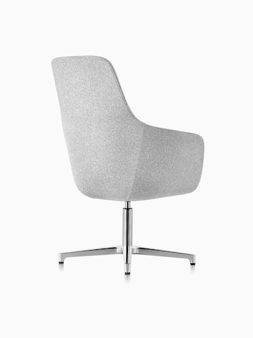 Three-quarter rear view of a high-back Saiba lounge chair in light gray fabric with a polished four-star base and glides.