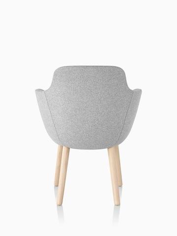 Rear view of a light gray Saiba Side Chair with an upholstered bucket seat and wood legs.