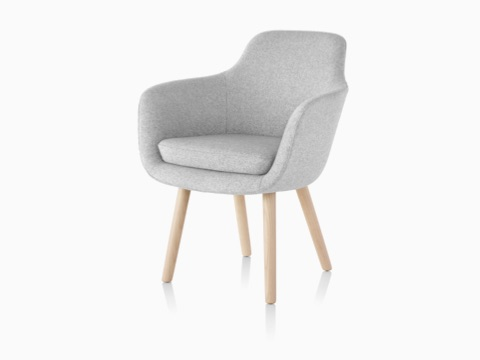 A light gray Saiba Side Chair, featuring an upholstered bucket seat and wood legs, viewed from a 45-degree angle.
