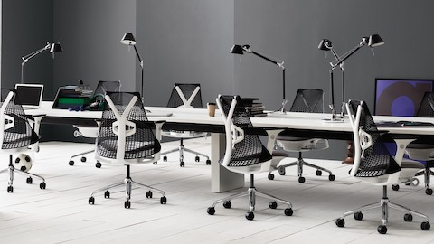 Black Sayl office chairs in a benching work environment.