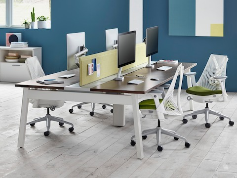 White Sayl office chairs with green upholstered seats in a benching work setting.