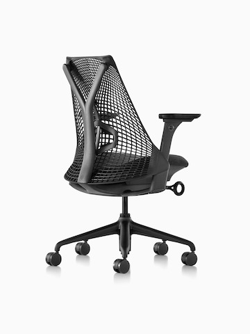 Three-quarters rear view of a black Sayl office chair with a suspension back.