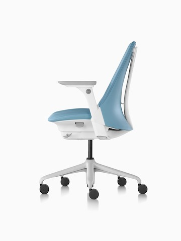 Profile view of a light blue Sayl office chair with an upholstered seat and back.