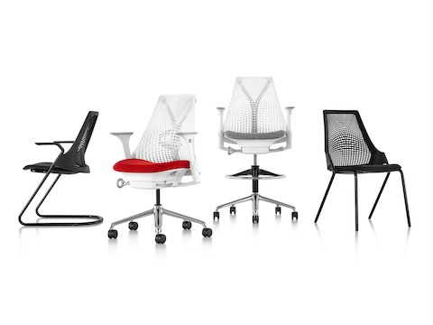 The Sayl seating family: black side chair with sled base, white work chair, white stool, and black stackable 4-leg side chair.