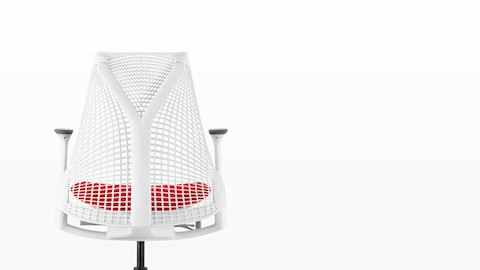 White Sayl office chair with suspension back and red upholstered seat, viewed from behind.