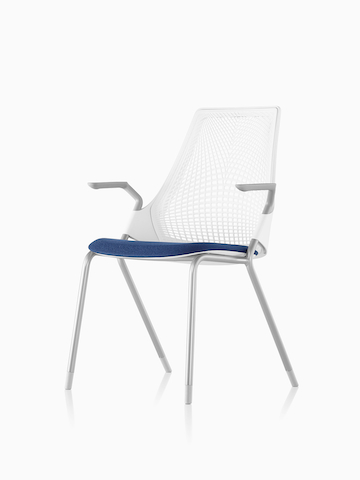 White Sayl Side Chair with a blue seat. Select to go to the Sayl Side Chairs product page.