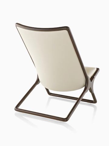 Cream Scissor Chair, viewed from the back at an angle.