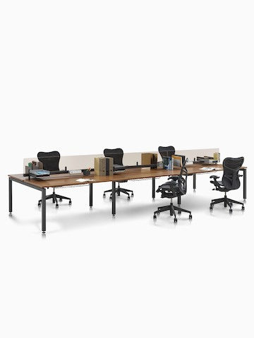 Sense Desks arranged in a benching configuration. Select to go to the Sense Desks product page.