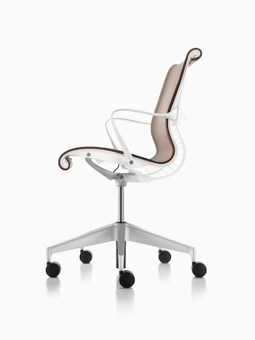Profile view of a light brown Setu office chair.
