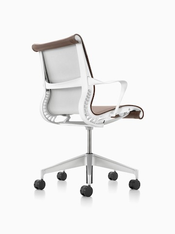 Light brown Setu office chair, viewed from the rear and side.
