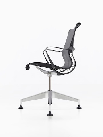 Profile view of a black Setu office chair.