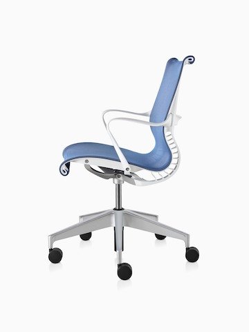 Profile view of a blue Setu office chair.