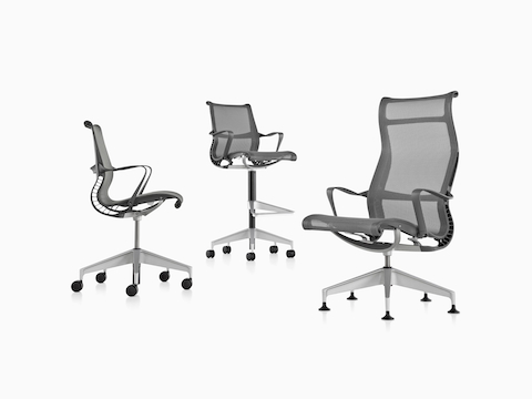 The Setu seating family: Black mid-back office chair, black stool, and black high-back office chair.