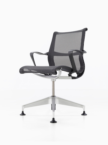 A black Setu Chair. Select to go to the Setu Chair product page.