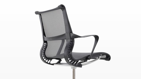 Three-quarter rear view of a black Setu office chair.